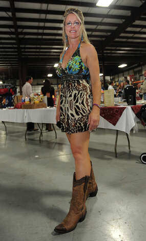 Dawn Burris show off her boots at the Cattle Barron's Ball on Saturday.  Photo taken Saturday, May 5, 2012 Guiseppe Barranco/The Enterprise Photo: Guiseppe Barranco, STAFF PHOTOGRAPHER / The Beaumont Enterprise