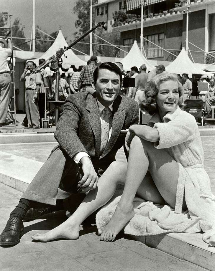 "In this image released by Beverly Hills Collection, actors Gregory Peck, left, and Lauren Bacall are seen while shooting the film ""Designing Woman"" at The Beverly Hills Hotel. Photo: Associated Press / Beverly Hills Collection"