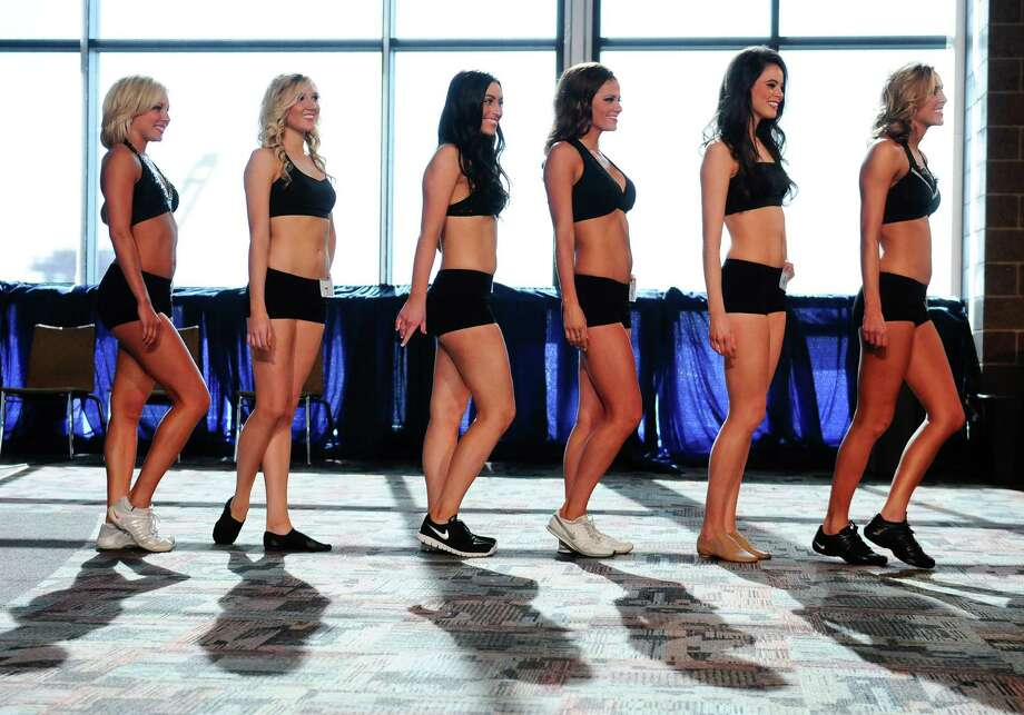 A group  files onstage to perform during the Sea Gals finals at CenturyLink Field on Sunday. A full squad of 32 women was chosen from the 60 finalists who performed during the live webcast. Photo: LINDSEY WASSON / SEATTLEPI.COM