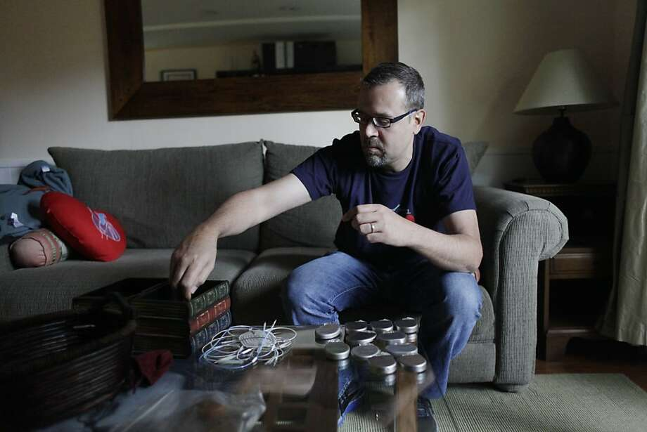 Hugo Campos of Oakland displays his collection of defibrillators which he started after being told he would have to have one on Thursday, May 3, 2012 in Oakland, Calif. Photo: Lea Suzuki, The Chronicle