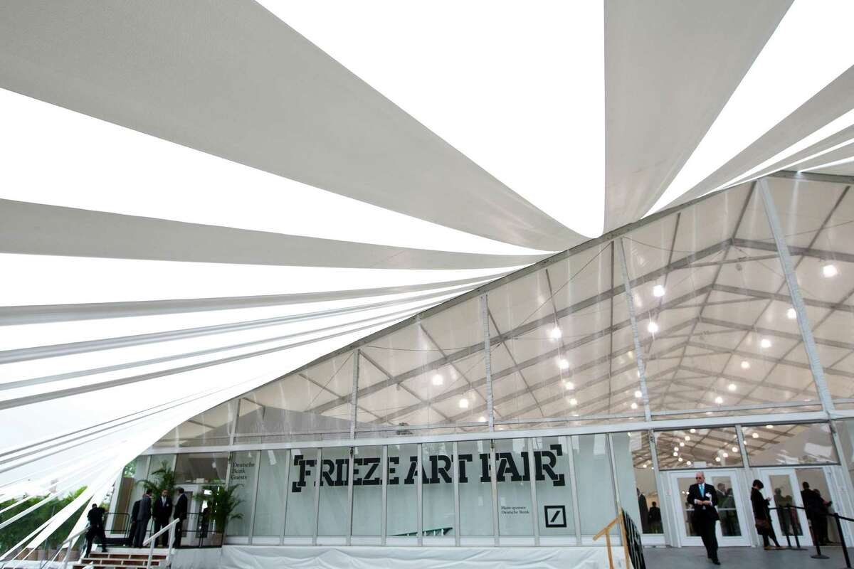The tent, designed by SO-IL, at Frieze New York, a contemporary art fair that originated in London nine years ago, and is now introducing a local franchise, at Randalls Island in New York, May 3, 2012. The fair will feature nearly 180 galleries, along with restaurants, bars, VIP lounges, an auditorium and a book store, and is installed in one long, curvaceous white tent. (Ruth Fremson/The New York Times)
