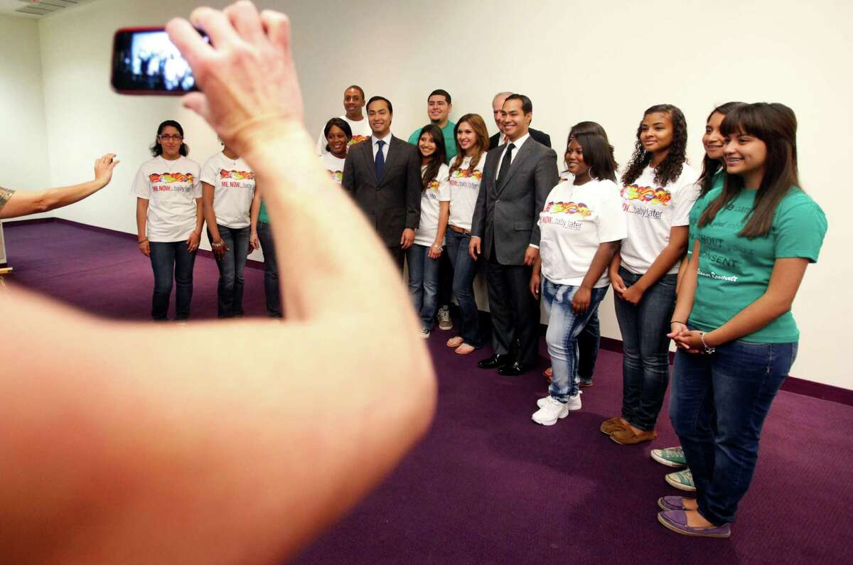 A handful of teenagers involved in advocating against teen pregnancy have their picture taken Wednesday April 2, 2012 at a news conference announcing new data on Texas and Bexar County teen birth rates during National Day to Prevent Teen Pregnancy with Joaquin and Julian Castro. (William Luther/wluther@express-news.net)