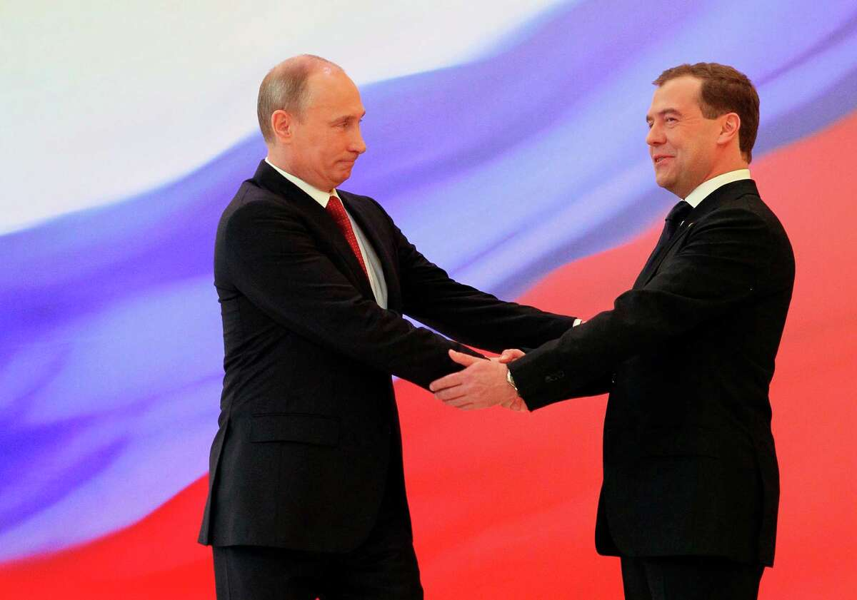 Russian President Vladimir Putin, left, and former President Dmitry Medvedev shakes hands at the inauguration ceremony in the Kremlin in Moscow on Monday. Vladimir Putin has been sworn in as Russia's president for a third term after four years as prime minister. (AP Photo/RIA Novosti Kremlin, Yekaterina Shtukina, Presidential Press Service)
