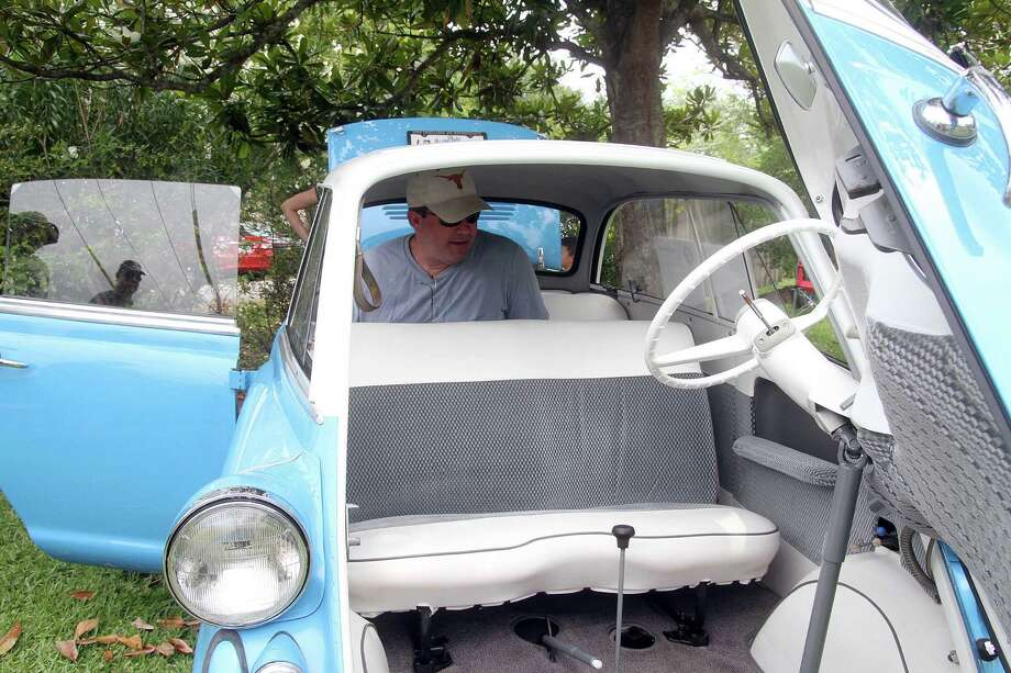 Craig Allen checks out the interior of a 1958 BMW Model 600 Sunday at the 17th annual Keels & Wheels at Seabrook. Photo by Pin Lim. Photo: Pin Lim, For The Chronicle / Copyright Pin Lim.