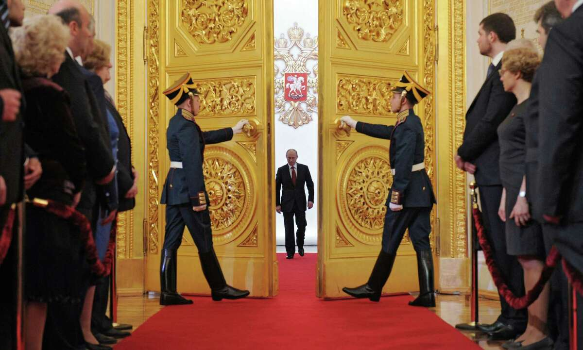 Vladimir Putin enters St. Andrew's Hall to take the oath of office during his inauguration as new Russia's president in the Grand Kremlin Palace in Moscow on Monday. Vladimir Putin has been sworn in as Russia's president for a third term after four years as prime minister. (AP Photo/RIA-Novosti, Alexei Druzhinin, Government Press Service)
