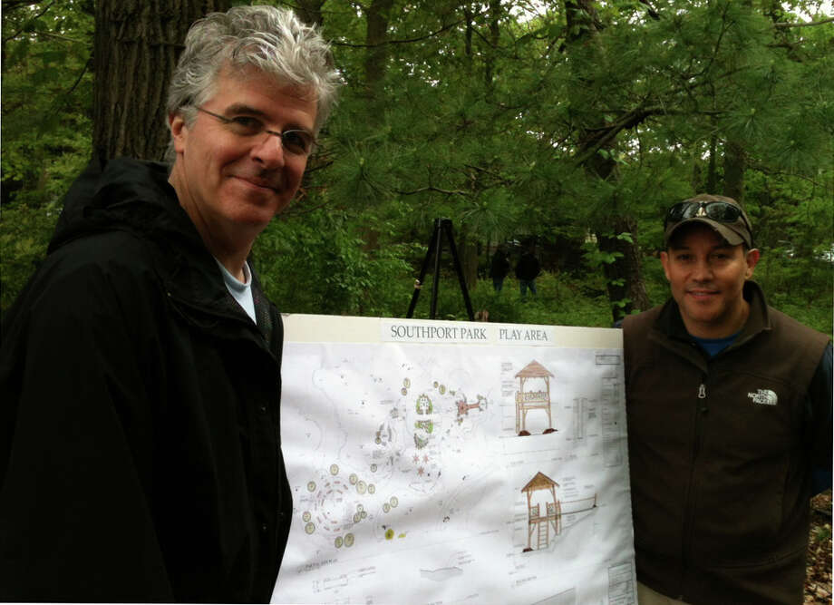 Stephen Stout, left, and Frank Festini stand by a rendering that shows a proposed lookout tower in Southport Park that the Sasquanuag Association plans to develop. Photo: Andrew Brophy / Fairfield Citizen contributed