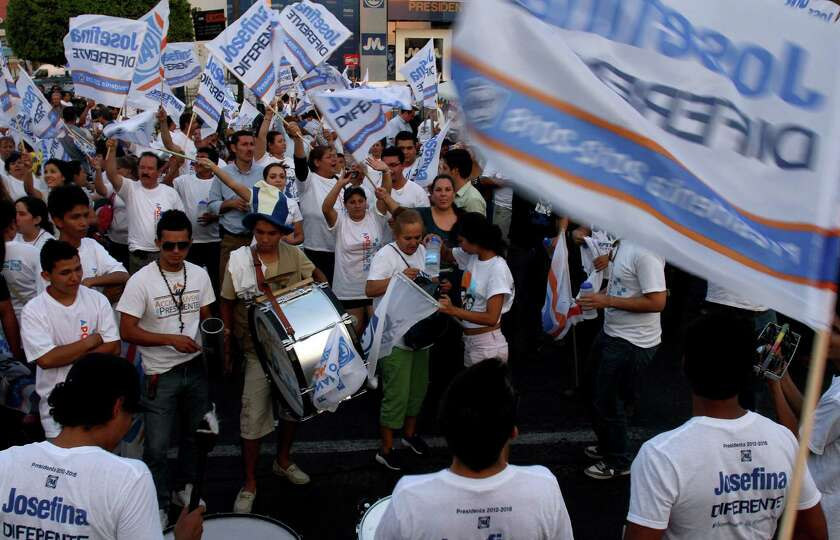 Supporters of Mexican presidential candidate for the National Action Party (PAN), Josefina Vazquez M