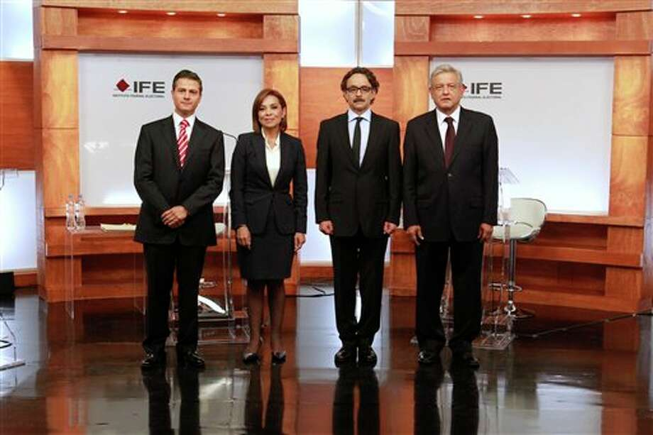 In this photo released by Mexico's Federal Electoral Institute (IFE), presidential candidates Enrique Pena Nieto (Revolutionary Institutional Party, PRI), left, Josefina Vazquez Mota (National Action Party, PAN), second from left, Gabriel Quadri (New Alliance Party, PANAL), third from left, and Andres Manuel Lopez Obrador (Democratic Revolution Party and Workers Party, PRD,PT), pose for a group photo prior to the start of the first presidential debate in Mexico City, Sunday May 6, 2012. Next July 1, Mexico will hold presidential election. (AP Photo/IFE) Photo: Associated Press / IFE
