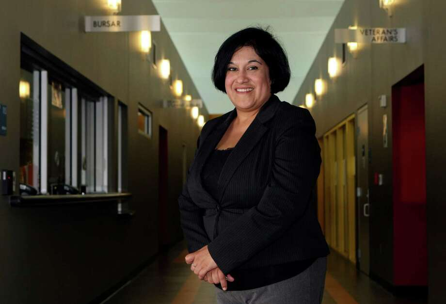 CONEXION:  Elizabeth Aguilar Villarreal, director of enrollment management at Palo Alto College.  She was Palo Alto's first person to ever enroll at the school in 1985.  Helen L. Montoya/Conexion Photo: HELEN L. MONTOYA, San Antonio Express-News / ©SAN ANTONIO EXPRESS-NEWS