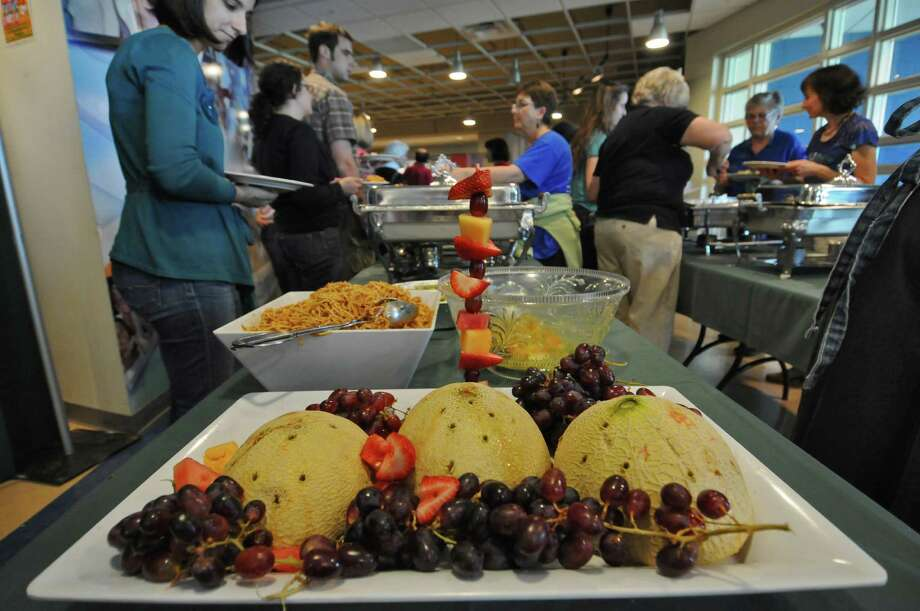 Some of the 500 people in attendance partake of the Capital District Community Gardens' 25th Annual Spring Brunch fundraiser at Hudson Valley Community College on Sunday May 6, 2012 in Troy, NY.  (Philip Kamrass / Times Union ) Photo: Philip Kamrass / 00017547A
