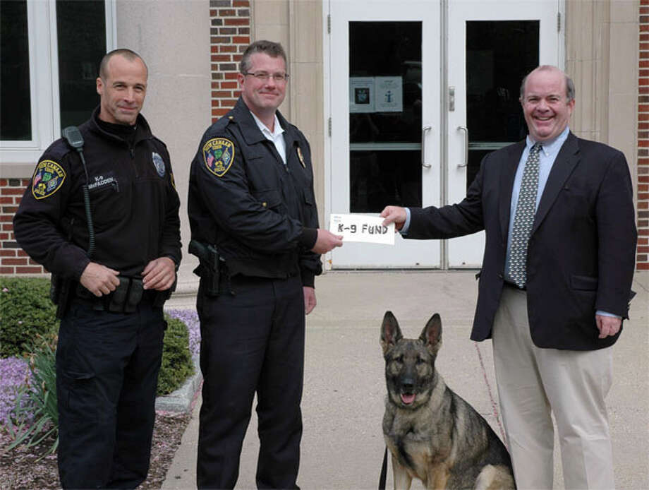 Bo Harrigan, of Harrigan Insurance in New Canaan delivered a donation of $2,000 to the New Canaan Police Departmentís K-9 fund. Accepting the check was Captain Leon Krolikowski and Officer Mike McFadden along with his K-9 partner Zira, a 4-year-old female German Shepherd from the Czech Republic. Photo: Contributed Photo