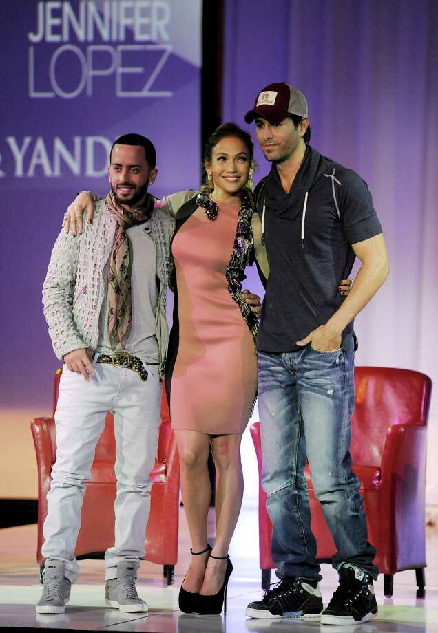 Yandel, left, of the group Wisin y Yandel, Jennifer Lopez, center, and Enrique Iglesias pose together after the announcement of their summer tour together, Monday, April 30, 2012, in Los Angeles. The initial 16 dates of the North American tour were announced on Monday, with more dates soon to be announced. Photo: AP