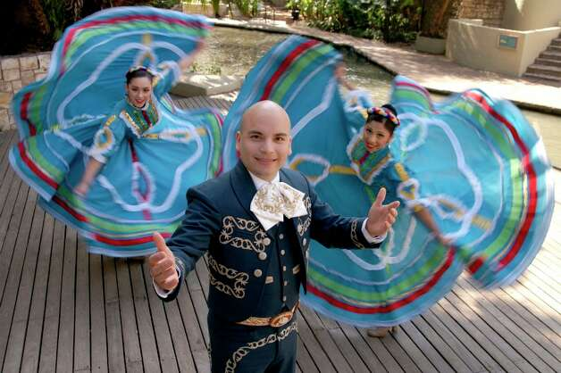 "Andrew Mauricio (center) is part of the cast for the 2012 ""Fiesta Noche del Rio."" Photo: Courtesy Creative Cafe"