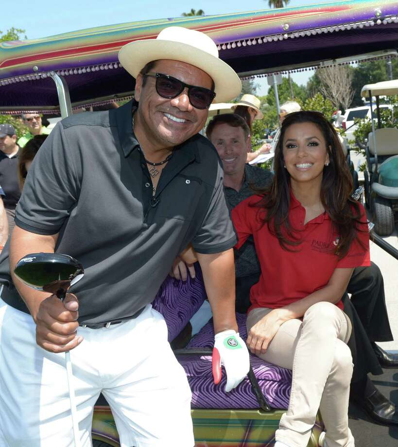 Comedian George Lopez (L) and actress Eva Longoria attends the 5th Annual George Lopez Celebrity Golf Classic at Lakeside Golf Club on May 7, 2012 in Toluca Lake, California. Photo: Michael Buckner, Getty Images For The Lopez Found / 2012 Getty Images