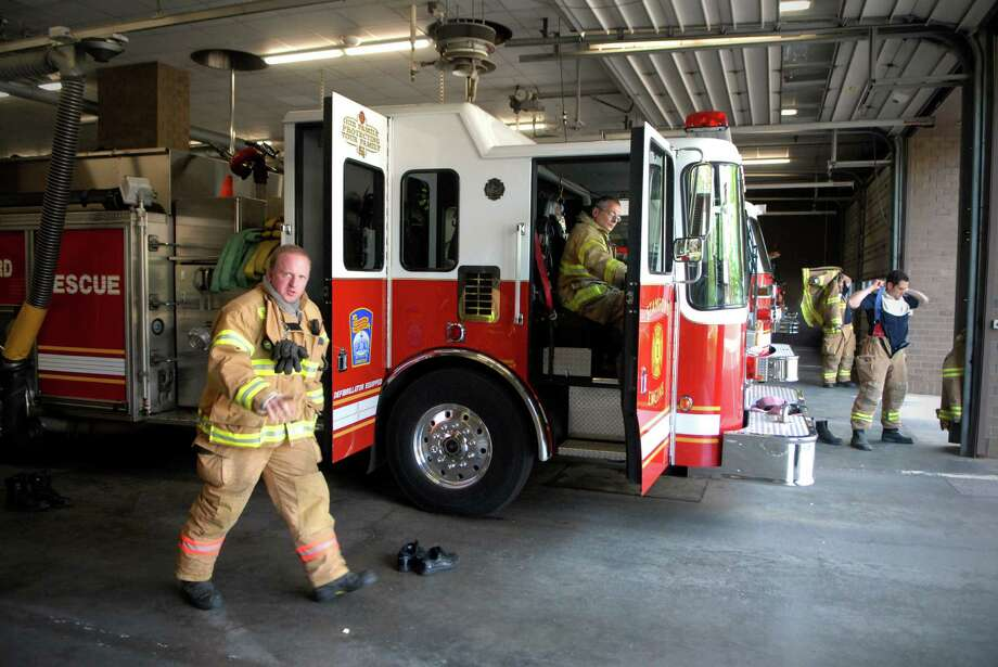 Firefighter James Doherty, Capt. Jimmy Romaniello and other firefighter respond to a call at the Central Fire Station in Stamford, Conn. on Monday May 7, 2012. Photo: Dru Nadler / Stamford Advocate Freelance