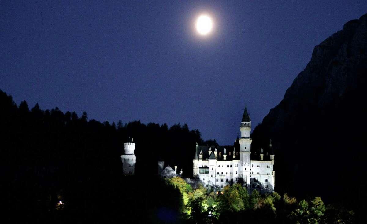 The moon rises over the 'fairy tale' castle Neuschwanstein, near Schwangau, Bavaria, Germany, on October 12, 2005.