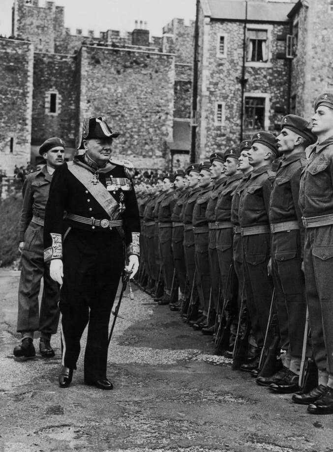 British Conservative Party Leader Winston Churchill (1874-1965) inspects the honor guard at Dover Castle after being installed as Lord Warden of the Cinque Ports, on August 14, 1946. Churchill was the first commoner to be honored in this way. Photo: Topical Press Agency, Getty Images / 2006 Getty Images
