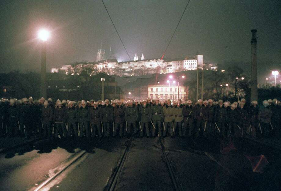 Riot police bar the bridge leading to the Castle of Hradcany, the seat of the Czechoslovakian presidency, on November 19, 1989 in downtown Prague, during a protest rally for democracy. The riot police later beat and arrested hundreds of demonstrators. The Communist government fell on December 10. Photo: LUBOMIR KOTEK, AFP/Getty Images / AFP
