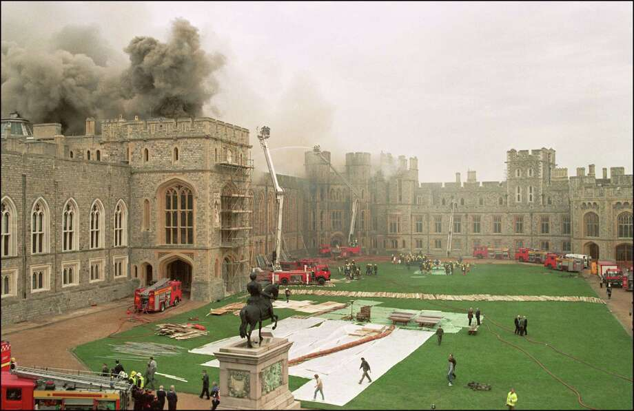 Firefighters battle a huge blaze at Windsor Castle, west of London, on November 20, 1992. The blaze reportedly started in the private St. George's Chapel. Photo: THIERRY SALIOU, AFP/Getty Images / AFP