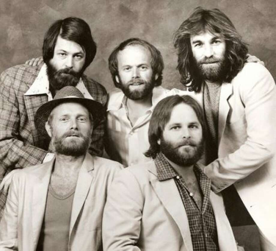 Beach Boys original members Carl Wilson and Dennis Wilson, brothers of Brian Wilson, are both dead. Carl Wilson died of cancer in 1998, and Dennis Wilson died in a drowning accident in 1983, after he had been drinking all day.