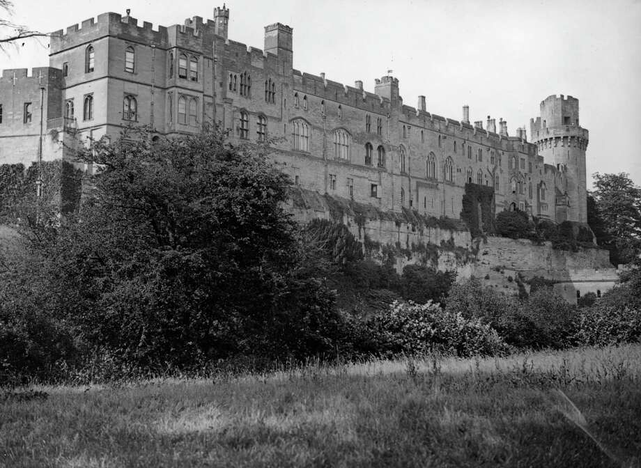 Warwick Castle, Warwick, Warwickshire, U.K., is shown circa 1950. The castle has been the seat of the earls of Warwick for 900 years. The existing buildings date mostly from the 14th century. Photo: Hulton Archive, Getty Images / Hulton Archive