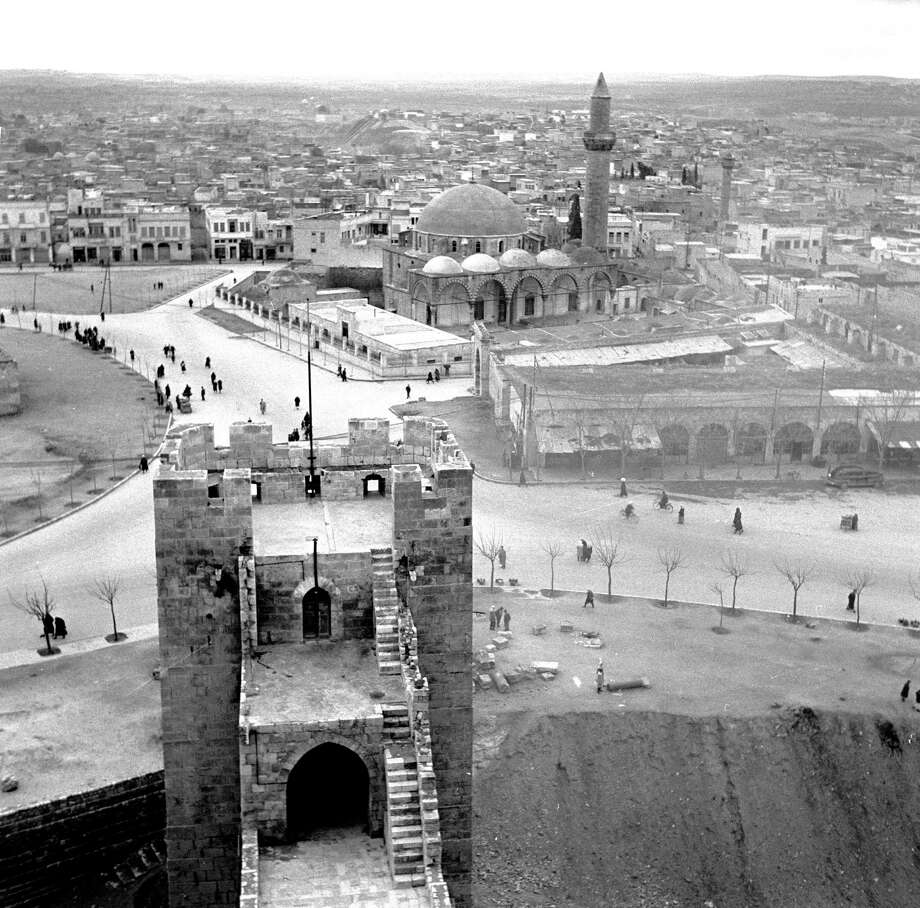 Aleppo, Syria, is seen from the city's citadel, circa 1950. Legend has it that the city was founded by Abraham. Photo: Evans, Getty Images / Hulton Archive