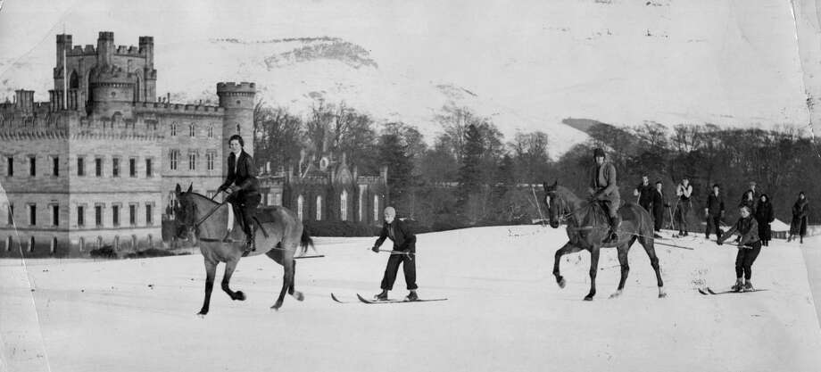 Horses pulls skiers across the snow in a sport known as ski-joring on December 31, 1931, in front of Taymouth Castle in Perthshire, central Scotland. The castle was built in the 19th century on the site of an older building dating back to the 16th century. It was the family seat of the Earl of Breadalbane and now overlooks Kenmore golf course. Photo: Hulton Archive, Getty Images / Hulton Archive