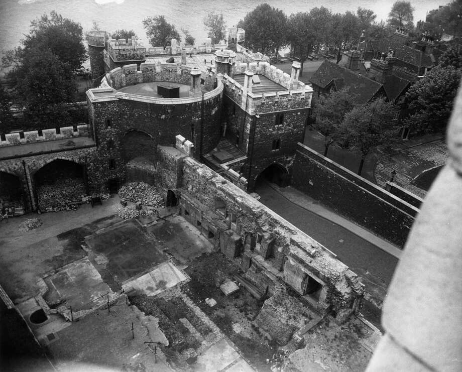 The ruins of the Bloody and Wakefield Towers in the Tower of London are seen from the White Tower, circa 1945. This part of the complex used to house the canteen. It was destroyed during a World War II bombing raid in 1940. Photo: Fox Photos, Getty Images / Hulton Archive
