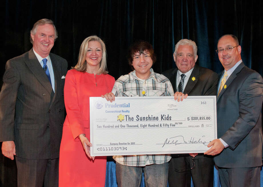 Prudential Connecticut Realty presents the Sunshine Kids with a check for $201,855. From Left, Peter Helie ,CEO of Prudential Connecticut Realty; Candace Adams, president of Prudential Connecticut Realty; Cory Pineau SSK spokesman; G.W. Bailey, executive director of the Sunshine Kids, star of âÄòMajor CrimesâÄù a spinoff of âÄúThe CloserâÄù; and Jim LaBanca, vice president of relocation at Prudential Connecticut Realty. Photo: Contributed Photo / New Canaan News