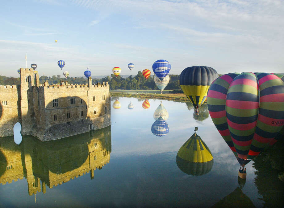 Hot air balloons take off at Leeds Castle near Maidstone in Kent, U.K. on September 14, 2003. The castle was hosting the balloon and vintage car weekend which was celebrating its 21st anniversary. More than 25 balloons took the the skies shortly after sunrise over the castle. Photo: ADRIAN DENNIS, AFP/Getty Images / 2003 AFP