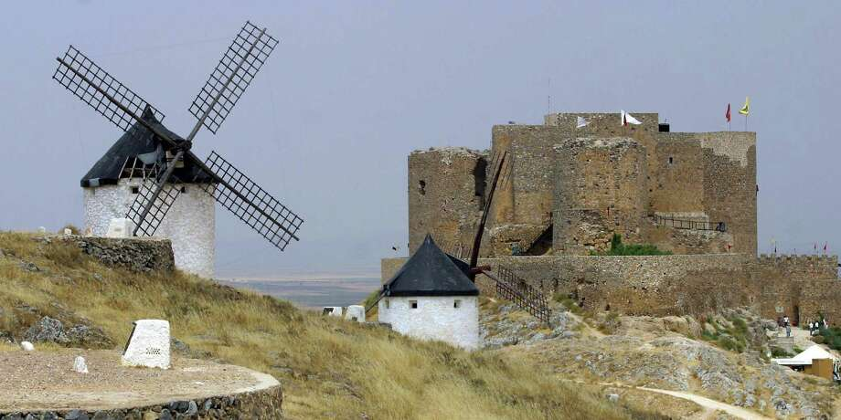The castle and windmills of Consuegra, Spain are shown on August 15, 2003, during a re-enactment of the 1097 battle of Consuegra. The battle pitted the forces of Alfonso VI, King of Leon and Castile, against the Almoravids, a Berber dynasty under emir Yusuf Ibn Tasufin. Photo: PEDRO ARMESTRE, AFP/Getty Images / 2003 AFP