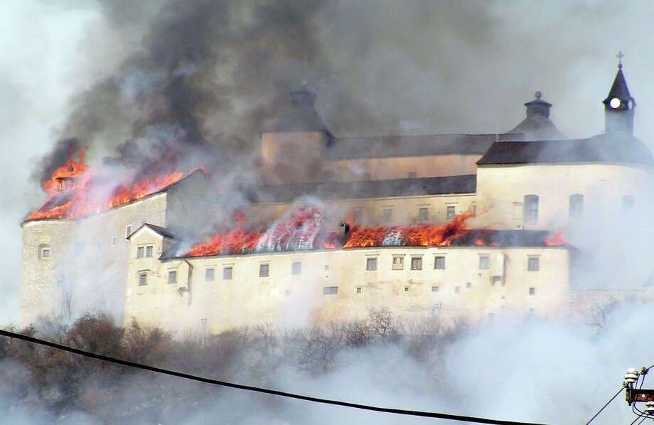 The Krasznahorka castle above the village of  Krasnohorske Podhradie, Slovakia blazes on March 10, 2012.The castle burned down, allegedly due to burning of dry grass. The roof of the castle was destroyed completely. Photo: AFP, AFP/Getty Images / 2012 AFP