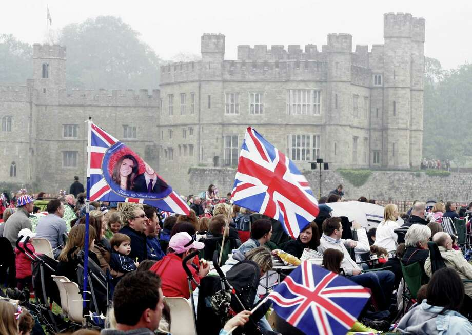 Spectators gather on the lawns to watch a broadcast during the wedding ceremony for the marriage of Prince William to Catherine Middleton at Leeds Castle on April 29, 2011 in Maidstone, England. Photo: Getty Images