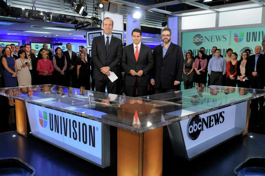 In this image released by ABC, ABC News president Ben Sherwood , left, Univision Networks president Cesar Conde, center, and Univision News president Isaac Lee pose as they announce the joint venture between ABC News and Univision News, Monday, May 7, 2012 in New York. (AP Photo/ABC, Lorenzo Bevilaqua) Photo: LORENZO BEVILAQUA