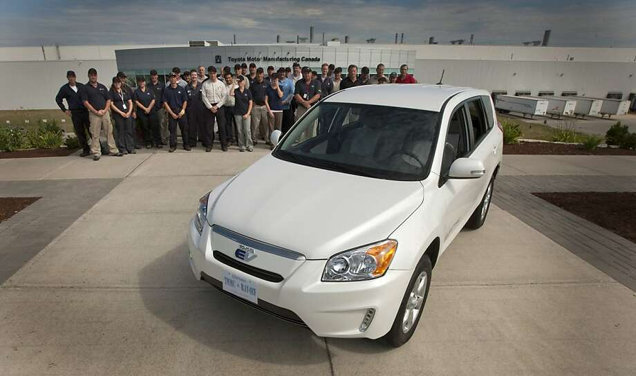 Toyota Motor Corp. employees stand for a photograph with the newly unveiled Toyota RAV4 electric vehicle (EV) outside of the company's assembly plant in Woodstock, Ontario, Canada, on Friday, Aug. 5, 2011. Toyota Motor Corp. and Tesla Motors Inc. said their jointly developed RAV4 electric vehicle will be built at Toyota's Woodstock plant starting in 2012. Photographer: Norm Betts/Bloomberg Photo: Norm Betts, Bloomberg