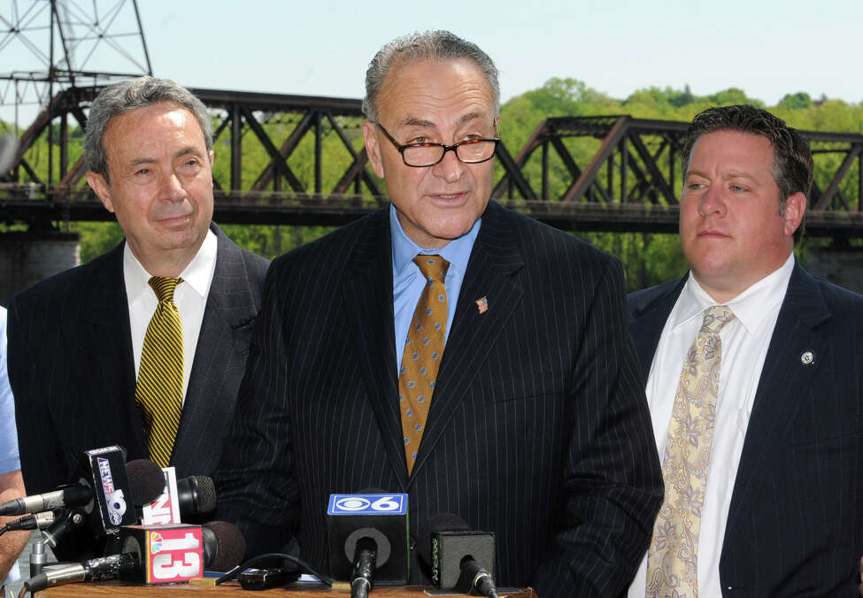 U.S. Senator Charles Schumers speaks at a press conference at the Corning Preserve Monday, May 7, 2012 in Albany, N.Y. Schumer is urging CSX, NYS Department of Transportation and Amtrak to include a pedestrian-friendly walkway as they set to develop plans to replace the Livingston Avenue rail bridge that links Albany and Rensselaer. Assemblyman Ron Canestrari and Albany County Executive Daniel McCoy listen in the background .(Lori Van Buren / Times Union)