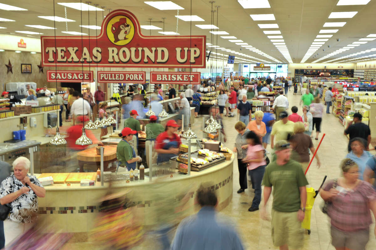 Shoppers descended on opening day of the Buc-ee's store in New Braunfels, Texas on 05/07/12. The store is the largest conveinience store in the world and features 60 fuel pumps, has 1000 parking spaces with 18 acres of concrete, takes up 67,000 square feet of building space, and has 250 employees.