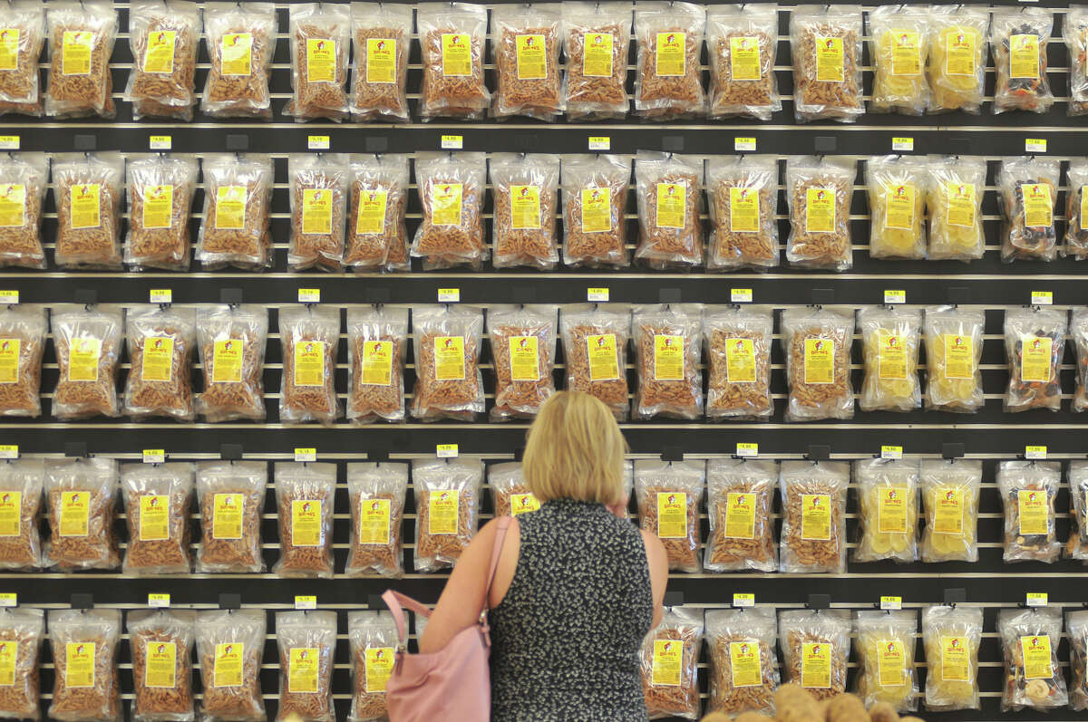 Karen Murphy of San Antonio looks over the selection of flavored sesame sticks at the new Buc-ee's store in New Braunfels Monday, May 7, 2012.