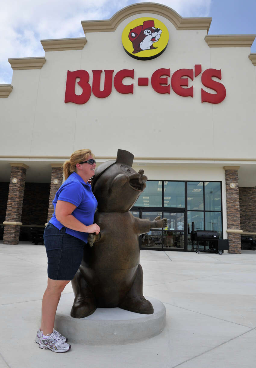 Terri Weaver poses for a picture with the Buc-ee the beaver statue at the newly opened Buc-ee's store in New Braunfels Monday, May 7, 2012. At 68,000 square feet, the store is the world's largest conveinience store. It features 60 fuel pumps, 1,000 parking spaces covering 18 acres of concrete and has 250 employees.