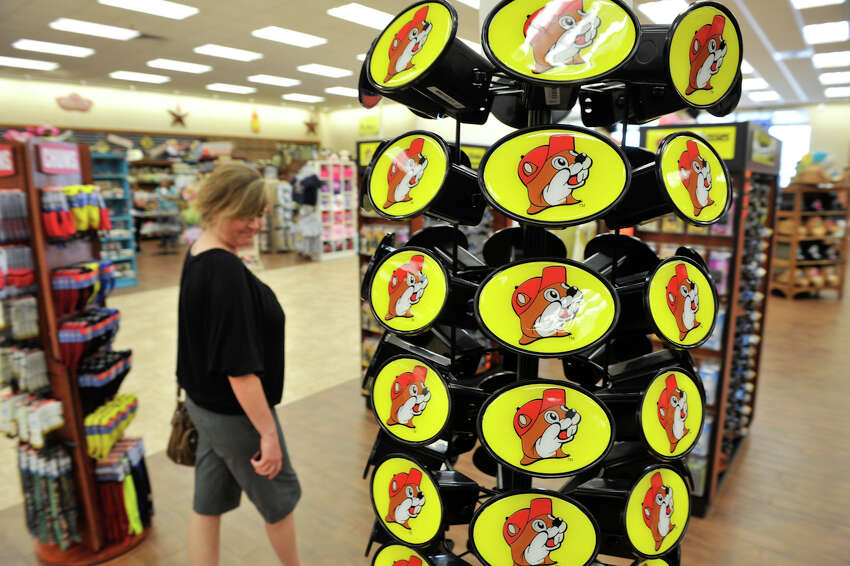 Rachel Langerwey of New Braunfels looks at Buc-ee the beaver hitch covers during the opening day of the Buc-ee's store in New Braunfels Monday, May 7, 2012. At 68,000 square feet, the store is the world's largest conveinience store. It features 60 fuel pumps, 1,000 parking spaces covering 18 acres of concrete and has 250 employees.
