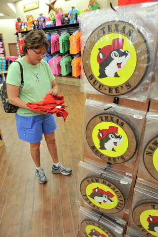 Karen Westerman looks over T-shirts on opening day of the Buc-ee's store in New Braunfels Monday, May 7, 2012. Photo: Robin Jerstad, For The Express-News