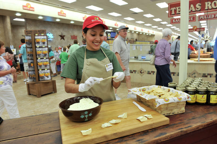 Estefania Abrego prepares samples of jalepeño cream cheese on opening day of the Buc-ee's store in New Braunfels Monday, May 7, 2012. Photo: Robin Jerstad, For The Express-News