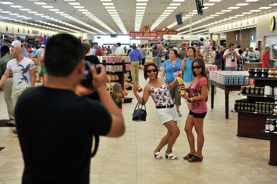 Visitors from the Philippines — Darrel Malsit (from left, with camera), Divina Beason and Wilma Gilliam — were among those at Buc-ee's new store in New Braunfels on its opening day. Photo: Robin Jerstad, For The Express-News