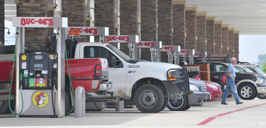 Motorists crowd the fuel pumps on opening day of the Buc-ee's store in New Braunfels Monday, May 7, 2012. Photo: Robin Jerstad, For The Express-News