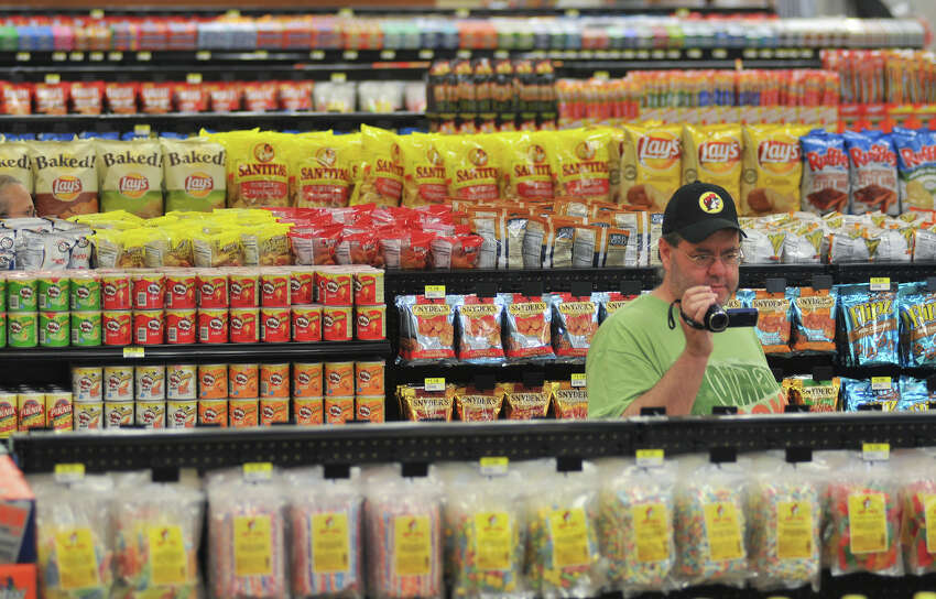 A customer uses a video camera to record the new Buc-ee's store in New Braunfels on opening day, Monday, May 7, 2012.