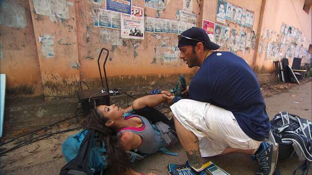 "Ralph Kelley helps Vanessa Macias after she suffers a leg injury  during ""The Amazing Race."" Photo: CBS Entertainment / �©2012 CBS Broadcasting, Inc. All Rights Reserved"