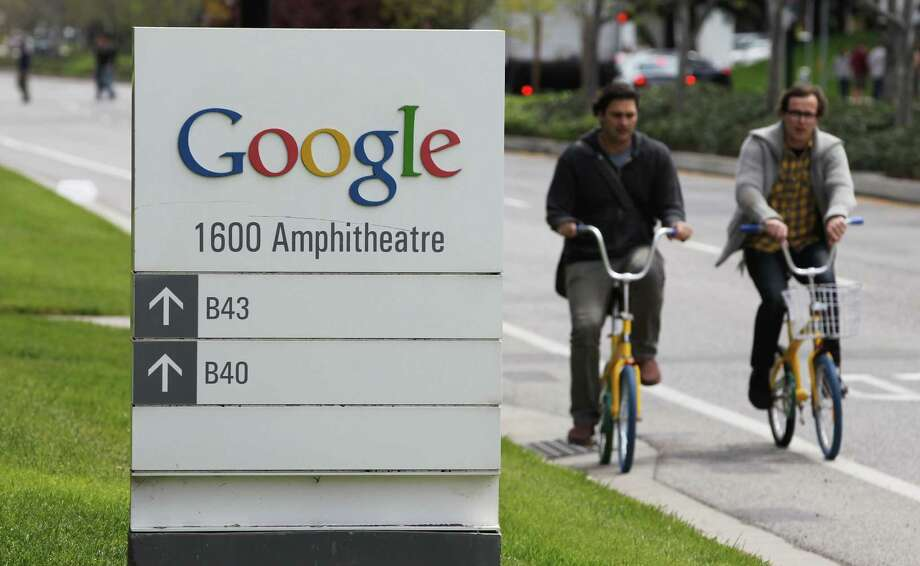 Workers bicycle past Google offices in Mountain View, Calif. A Google-Oracle dispute continues despite Monday's verdict. Photo: Paul Sakuma / AP