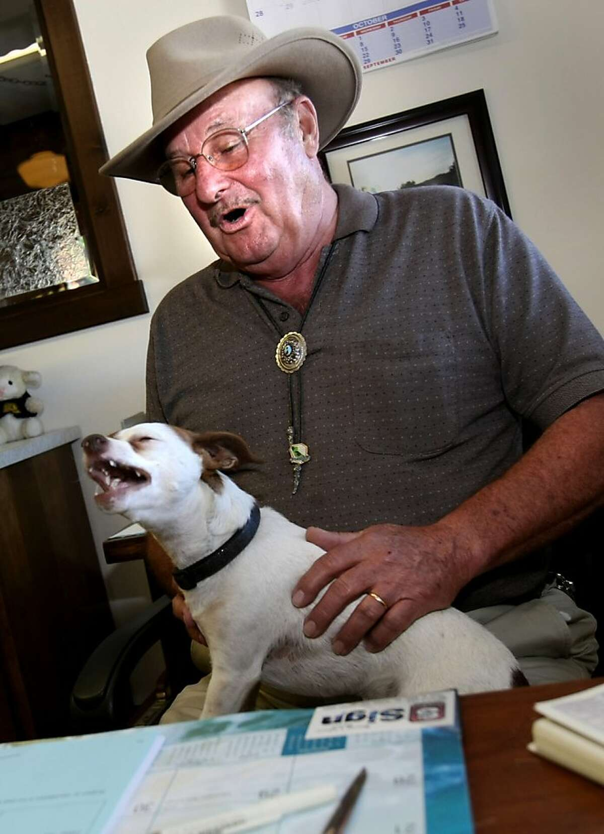 """Leo """"T"""" Bergeron sits at his desk in Yreka, CA with his dog, Trouble. Bergeron and Grange halls throughout the area are seriously pushing the idea of a state of Jefferson. Some residents of northern California and southern Oregon are again talking about seceding from the United States and forming their own state called Jefferson."""
