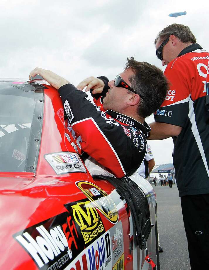 Driver Tony Stewart climbs out of his car after qualifying for Sunday's NASCAR Sprint Sprint Cup Series  Cup series auto race at Talladega Superspeedway, Saturday, May 5, 2012, in Talladega. (AP Photo/John Bazemore) Photo: John Bazemore