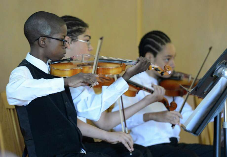 Members of the Giffen Elementary School Orchestra play during the launch of the Albany Promise initiative which is aimed at improving educational opportunities for children from the region's poorest neighborhoods at an assembly at the Giffen Elementary School in Albany, N.Y. May 7, 2012.  (Skip Dickstein / Times Union) Photo: SKIP DICKSTEIN